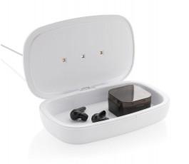 Estirilizador UV-C con cargador inalambrico con elementos en el interior