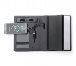carpeta color negro con power bank abierta con bloc y telefono conectado
