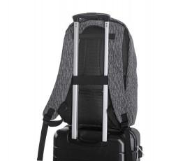 vista de mochila antirrobo reflectante para portatil y tablet en luz nocturna acoplada a trolley