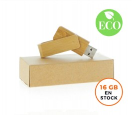 memoria usb de bambu encima de caja de carton y con sello ECO